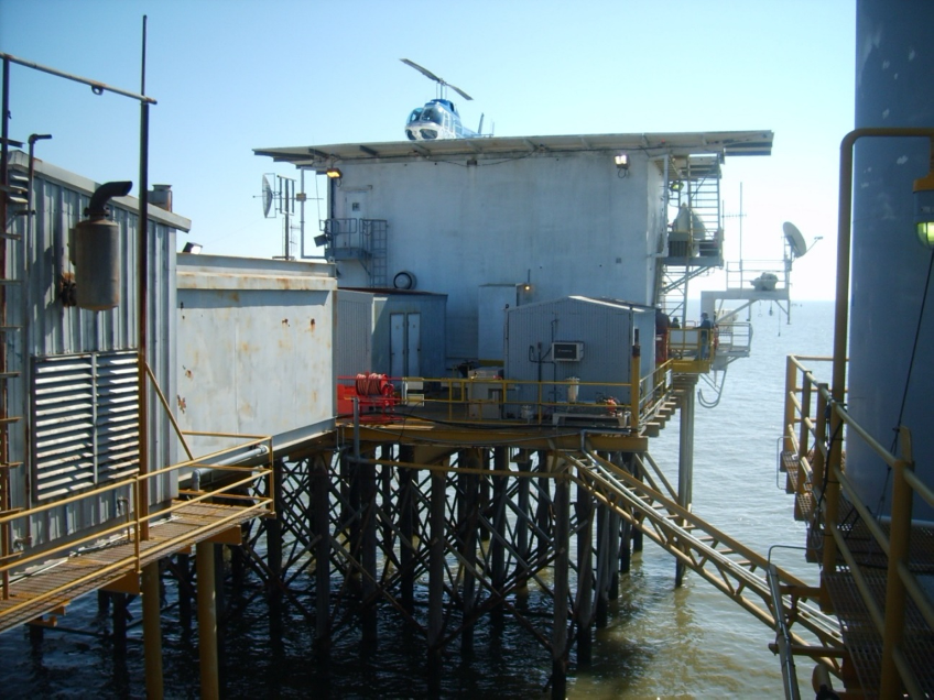 Offshore living quarters supported by timber pilings